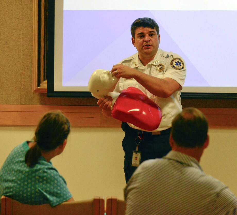 Colin Bassett of the Greenwich Emergency Medical Service, along with the Greenwich Health Department, give a joint presentation on the use of Narcan and how people can respond to opioid overdoses. A couple dozen residents attended the hour long class and information seminar at the Greenwich Library on July 31, 2018 in Greenwich, Connecticut. Photo: Matthew Brown / Hearst Connecticut Media / Stamford Advocate