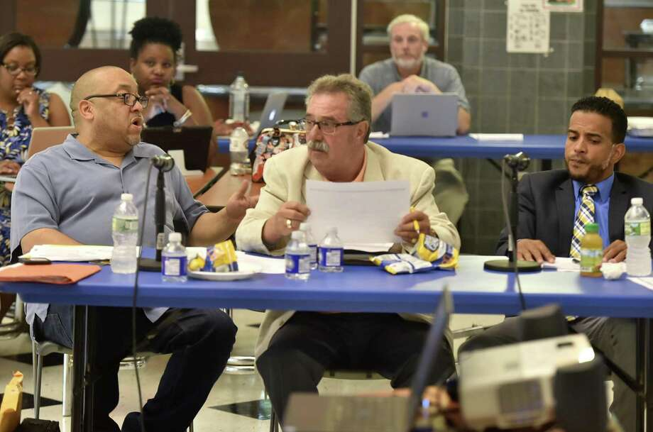 New Haven, Connecticut - Tuesday,  July 31, 2018: New Haven Board of Education president Darnell Goldson, left, BOE member Frank Redente and board vice-president Jamell Cotto during the New Haven Board of Education Board Retreat Tuesday evening at the Celentano School in New Haven. Photo: Peter Hvizdak / Hearst Connecticut Media / New Haven Register