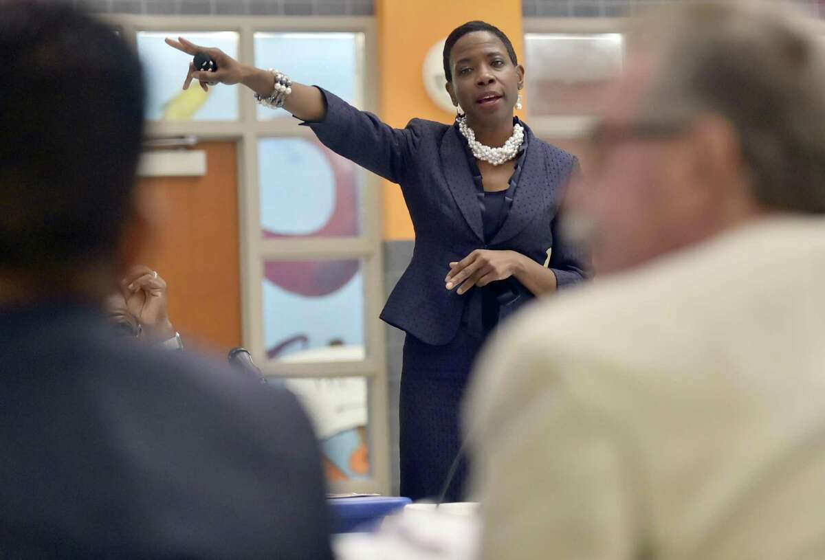 New Haven Superintendent of Schools Carol Birks answers a question from Board of Education Vice President Jamell Coto about her new organizational plan Tuesday at the Celentano School in New Haven.