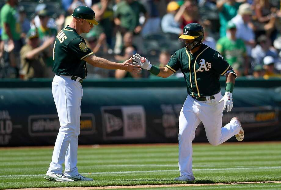 OAKLAND, CA - AUGUST 01:  Franklin Barreto #1 of the Oakland Athletics is congratulated by third base coach Matt Williams after Barreto hit a solo home run against the Toronto Blue Jays in the bottom of the eighth inning at Oakland Alameda Coliseum on August 1, 2018 in Oakland, California. The Athletics won the game 8-3.  (Photo by Thearon W. Henderson/Getty Images) Photo: Thearon W. Henderson / Getty Images