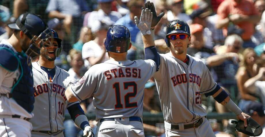 SEATTLE, WA - AUGUST 01:  Max Stassi #12 of the Houston Astros is greeted by Yuli Gurriel #10 and Josh Reddick #22 after they scored on his three run home run against the Seattle Mariners in the fifth inning at Safeco Field on August 1, 2018 in Seattle, Washington. (Photo by Lindsey Wasson/Getty Images) Photo: Lindsey Wasson/Getty Images