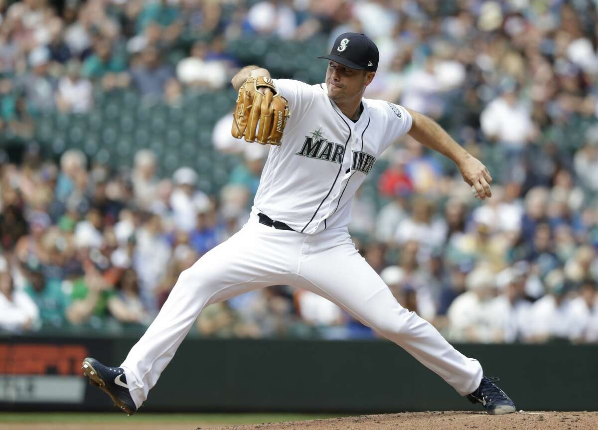 Seattle Mariners starting pitcher Wade LeBlanc throws against the Houston Astros in a baseball game Wednesday, Aug. 1, 2018, in Seattle. (AP Photo/Elaine Thompson)