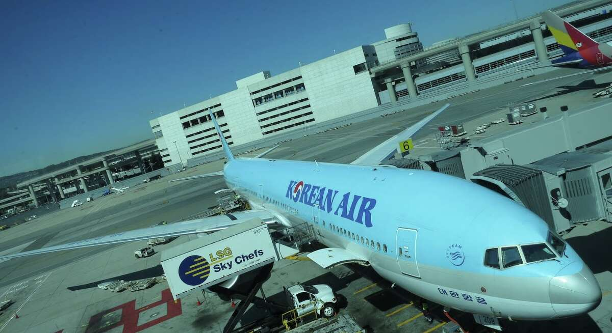 In Seoul, a woman was reportedly dragged out of business class on a Korean Air 777 like this one parked at SFO