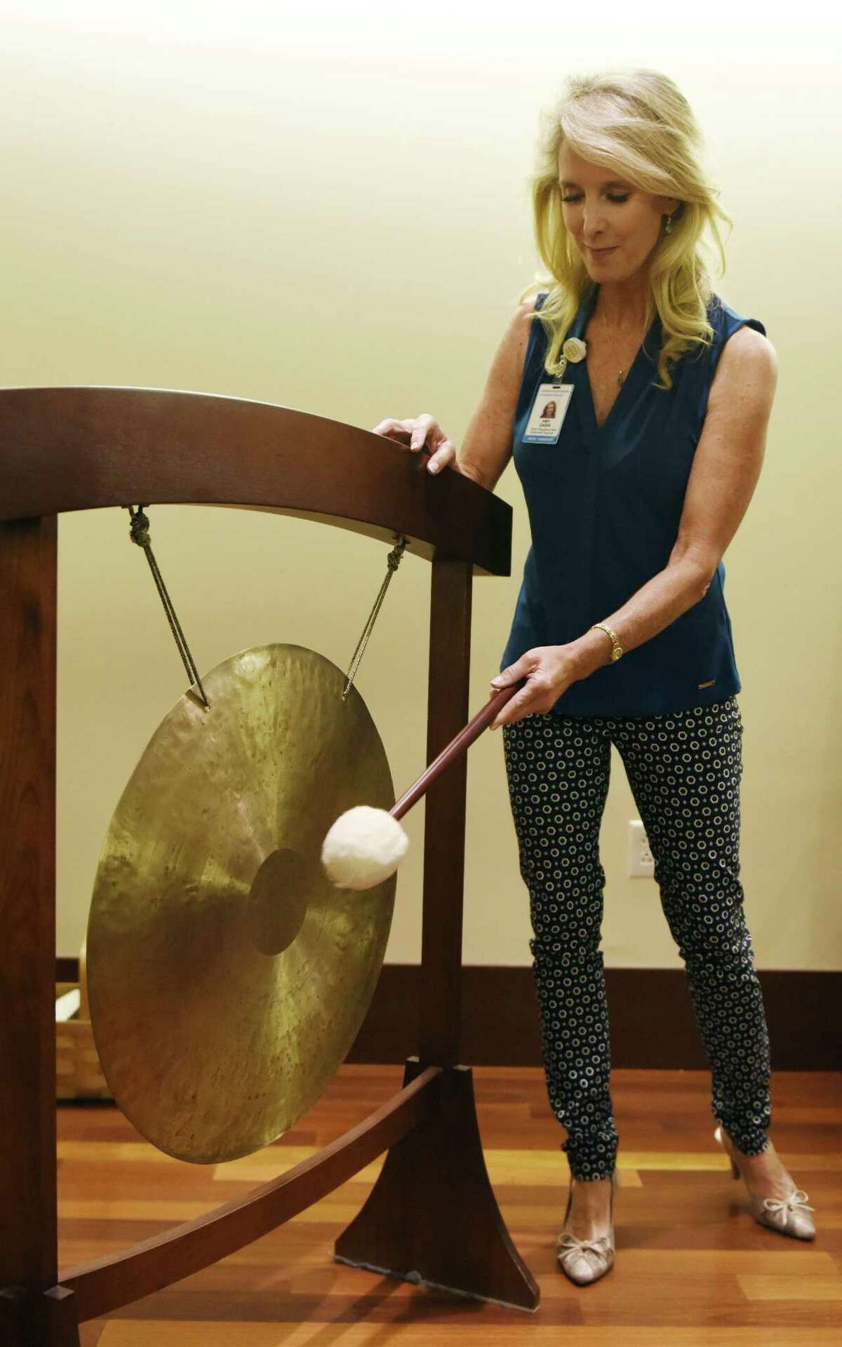 Music therapist Dr. Amy Zabindemonstrates an aspect of her music therapy on the gong at Greenwich Hospital in Greenwich on Wednesday.