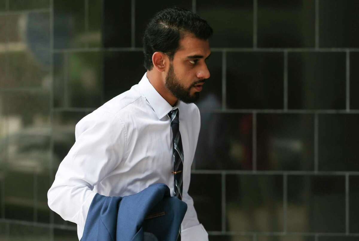 Asher Abid Khan, 23, of Spring, walks toward the United States District Courthouse for his sentencing before a federal court judge on Monday, June 25, 2018, in Houston. Khan was a University of Houston student who admitted he plotted to join the jihadist fight in Syria. ( Yi-Chin Lee / Houston Chronicle )
