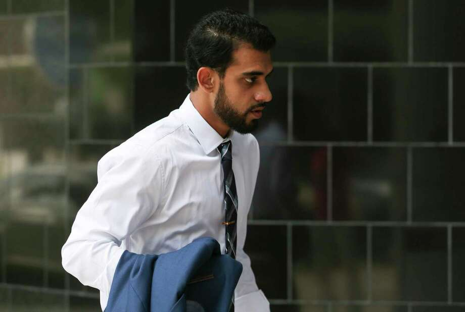 Asher Abid Khan, 23, of Spring, walks toward the United States District Courthouse for his sentencing before a federal court judge on Monday, June 25, 2018, in Houston. Khan was a University of Houston student who admitted he plotted to join the jihadist fight in Syria. ( Yi-Chin Lee / Houston Chronicle ) Photo: Yi-Chin Lee / Houston Chronicle / © 2018 Houston Chronicle