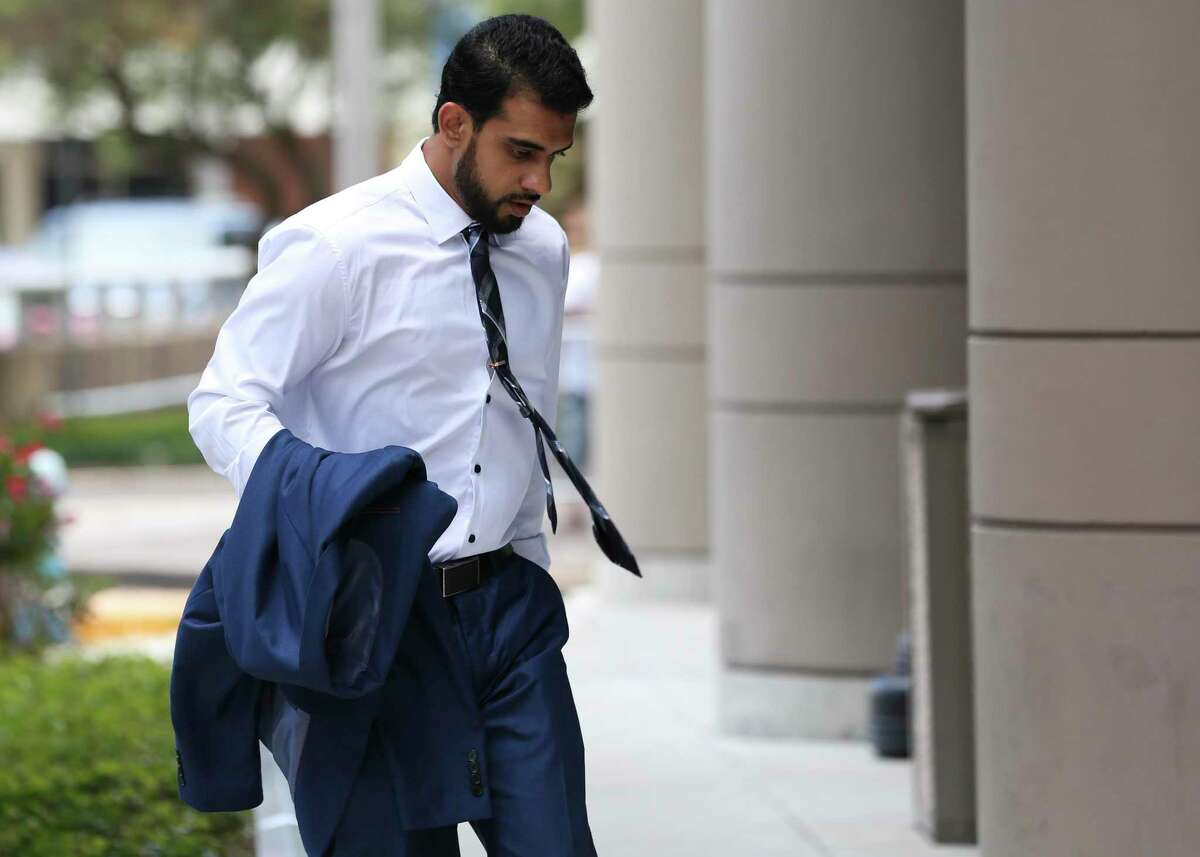 Asher Abid Khan, of Spring, walks toward the United States District Courthouse for his sentencing before a federal court judge on June 25, 2018, in Houston. Khan was a University of Houston student who admitted he plotted to join the jihadist fight in Syria. ( Yi-Chin Lee / Houston Chronicle )