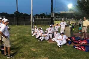 Manager David Rook and his two assistant coaches — John Klosek & David Wylie  —  talking to the Post Oak Little League team.