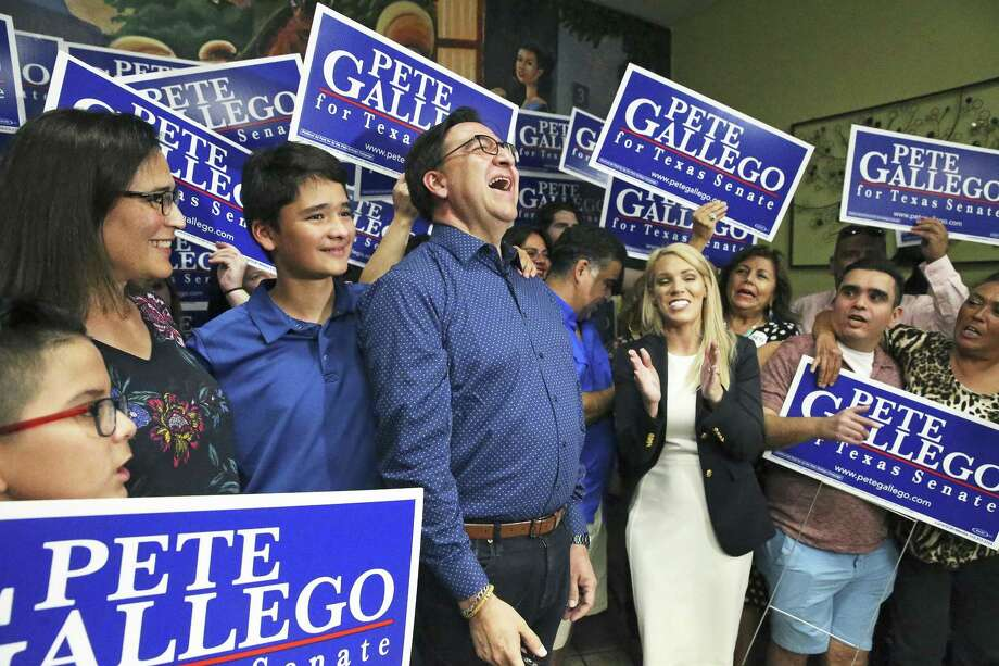 Former U.S. Rep. Pete Gallego celebrates as he meets with his supporters at an election night party Tuesday. He will face Republican Pete Flores in the Texas Senate District 19 runoff. Photo: Tom Reel /Staff Photographer / 2017 SAN ANTONIO EXPRESS-NEWS