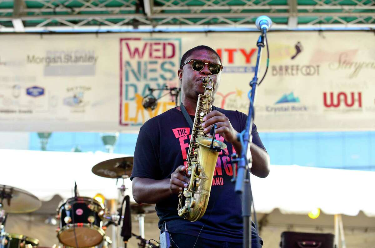 Colin Walters of Stamford along with members of the Funky Dawgz Brass Band open up for Trombone Shorty and Orleans Avenue as they perform the final Wednesday Night Live concert at Columbus Park in Stamford, Connecticut on August 1, 2018.