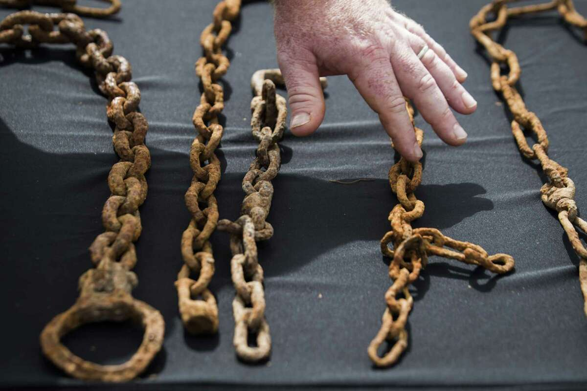 This July 16, 2018 photo shows chains discovered at a historic burial site at a school construction site in Sugar Land, Texas.