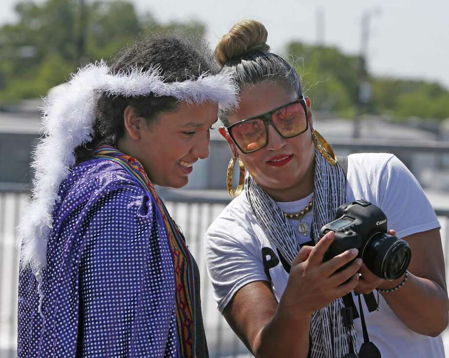 Several local female photographers will work with more than 30 girls from the Girls Zone Summer Camp on how to use photography to document good things about their East Side neighborhood on Wednesday, Aug.1, 2018. Photo: Ronald Cortes, Photo Correspondent / 2018 Ronald Cortes
