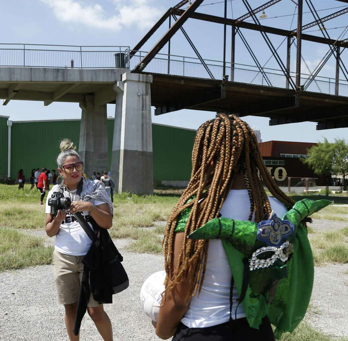 Kristel A. Orta-Puente prepares to photograph Keyalana Bethel,15. Several local female photographers will work with more than 30 girls from the Girls Zone Summer Camp on how to use photography to document good things about their East Side neighborhood on Wednesday, Aug.1, 2018.