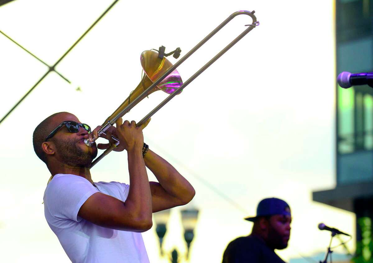 Troy Andrews, also known by the stage name Trombone Shorty and members of the Orleans Avenue band close out the Wednesday Night Live concert series at Columbus Park in Stamford, Connecticut on August 1, 2018.