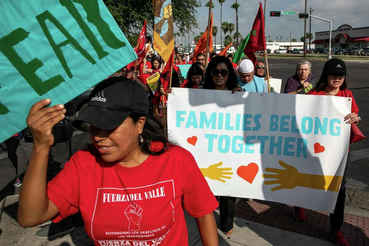 Immigrant advocates gather to protest on the day of the court-imposed deadline for family reunification outside the federal courthouse in McAllen, Texas, July 26, 2018. Lawyers are seeking to prevent the Trump administration from deporting up to 900 newly-reunited migrant families. (Ilana Panich-Linsman/The New York Times)