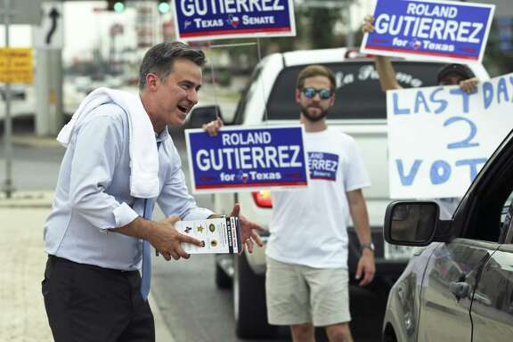 Roland Gutierrez campaigns for last minute votes at the intersection of I35 and SW Military on July 31, 2018.