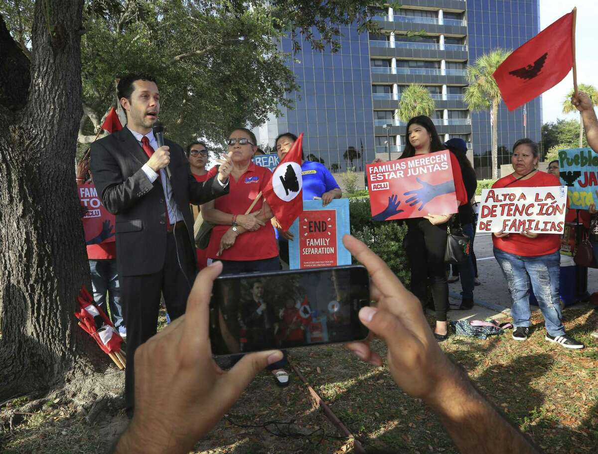 Efrén Olivarez, a lawyer with the Texas Civil Rights Project, talks about his organization's work with representing migrants who are separated from their families while in federal detention during a protest as it is broadcast live on the internet Thursday, July 26, 2018, in front of the federal courthouse in McAllen, Texas. Thursday marked the court-ordered deadline for U.S. government to reunify migrant children with their families. (Nathan Lambrecht/The Monitor via AP)