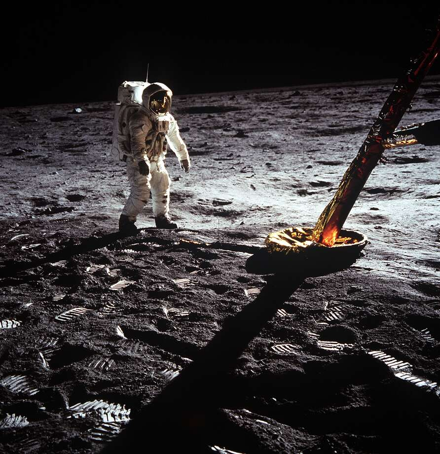 "20 July 1969) --- Astronaut Edwin E. Aldrin Jr., lunar module pilot, walks on the surface of the moon near a leg of the Lunar Module during the Apollo 11 extravehicular activity (EVA). Astronaut Neil A. Armstrong, Apollo 11 commander, took this photograph with a 70mm lunar surface camera. The astronauts' bootprints are clearly visible in the foreground. While astronauts Armstrong and Aldrin descended in the Lunar Module (LM) ""Eagle"" to explore the Sea of Tranquility region of the moon, astronaut Michael Collins, command module pilot, remained with the Command and Service Modules (CSM) ""Columbia"" in lunar orbit. (NASA)"