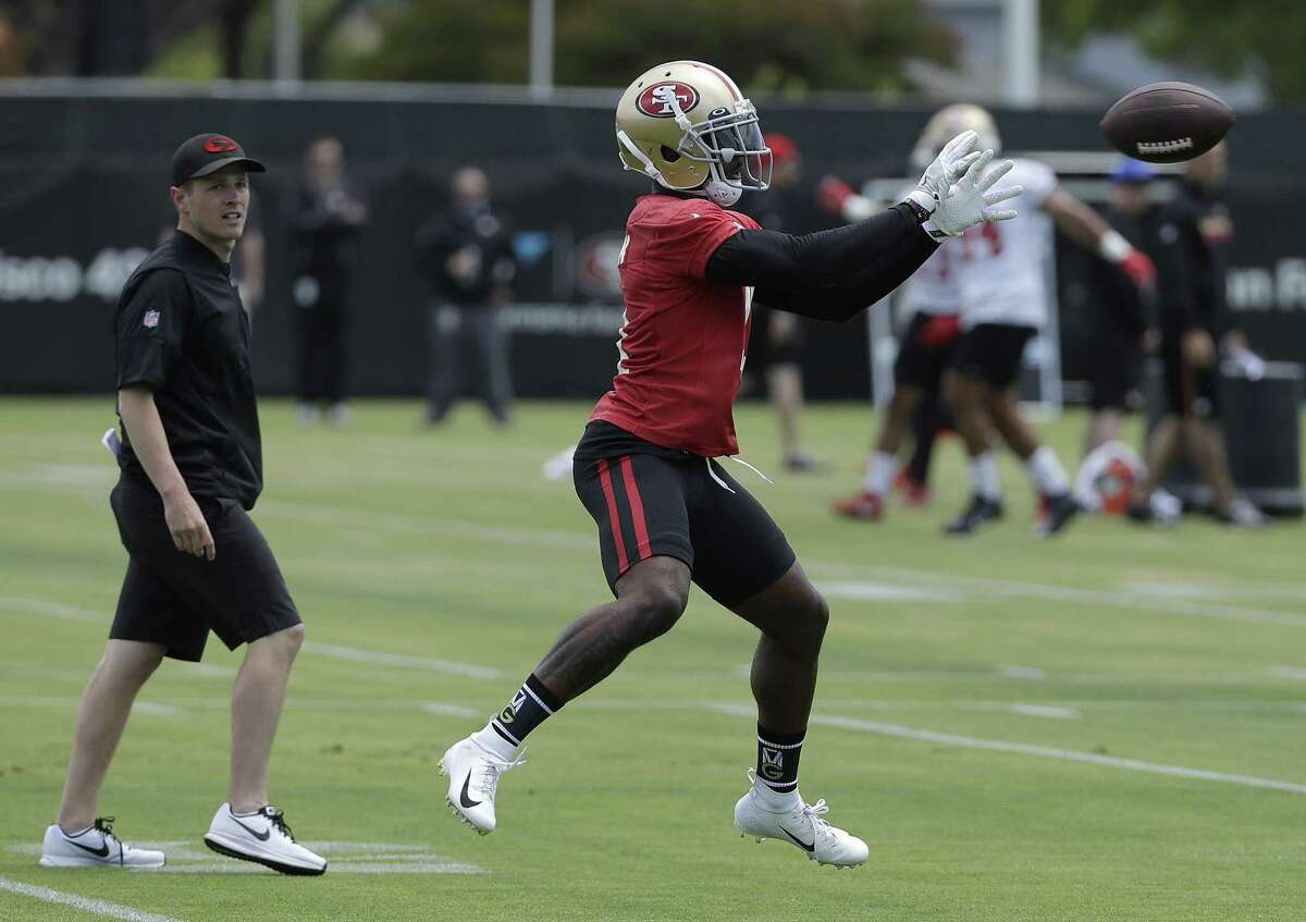 San Francisco 49ers wide receiver Marquise Goodwin catches a pass during a practice at the team's NFL football training facility in Santa Clara, Calif., Wednesday, May 30, 2018. (AP Photo/Jeff Chiu)