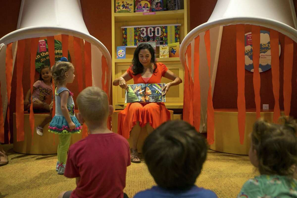 """Author Xelena Gonz‡lez reads her book """"All Around Us"""" at The DoSeum July 7, 2018. """"All Around Us"""" has been honored with a notable children's book and the 2018 Texas Institute of Letters Literary Award for best picture book."""
