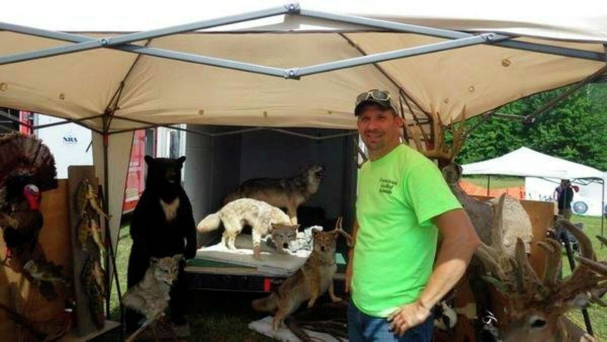 Kevin Klee of Nature's Finest Taxidermy in Minden City was on hand toexplain proper field care of trophieslast Saturday during the annual Grindstone-Port Hope Sportsmen's Club Kids Day. (Tom Lounsbury/Hearst Michigan)
