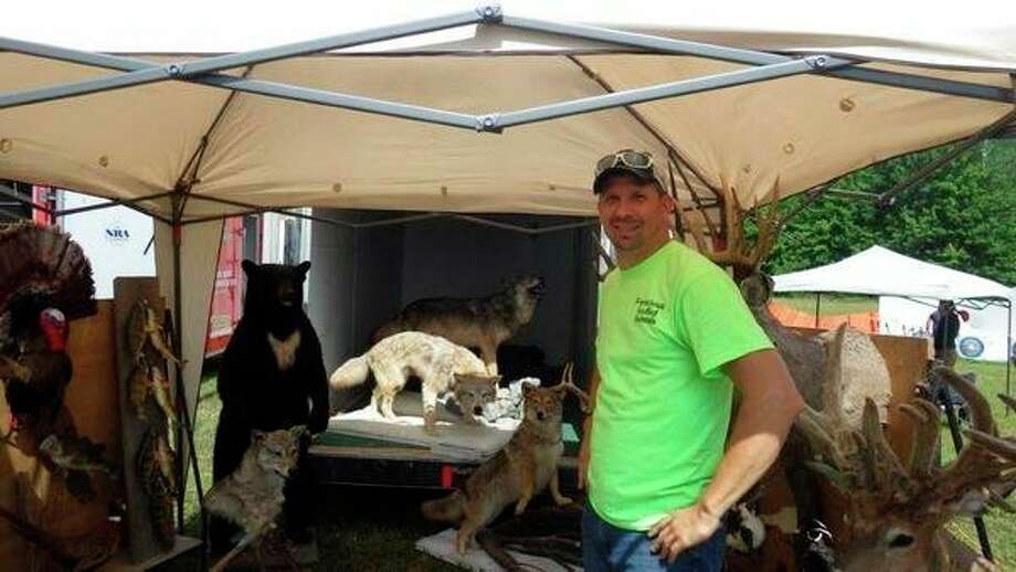 Kevin Klee of Nature's Finest Taxidermy in Minden City was on hand to explain proper field care of trophies last Saturday during the annual Grindstone-Port Hope Sportsmen's Club Kids Day. (Tom Lounsbury/Hearst Michigan)