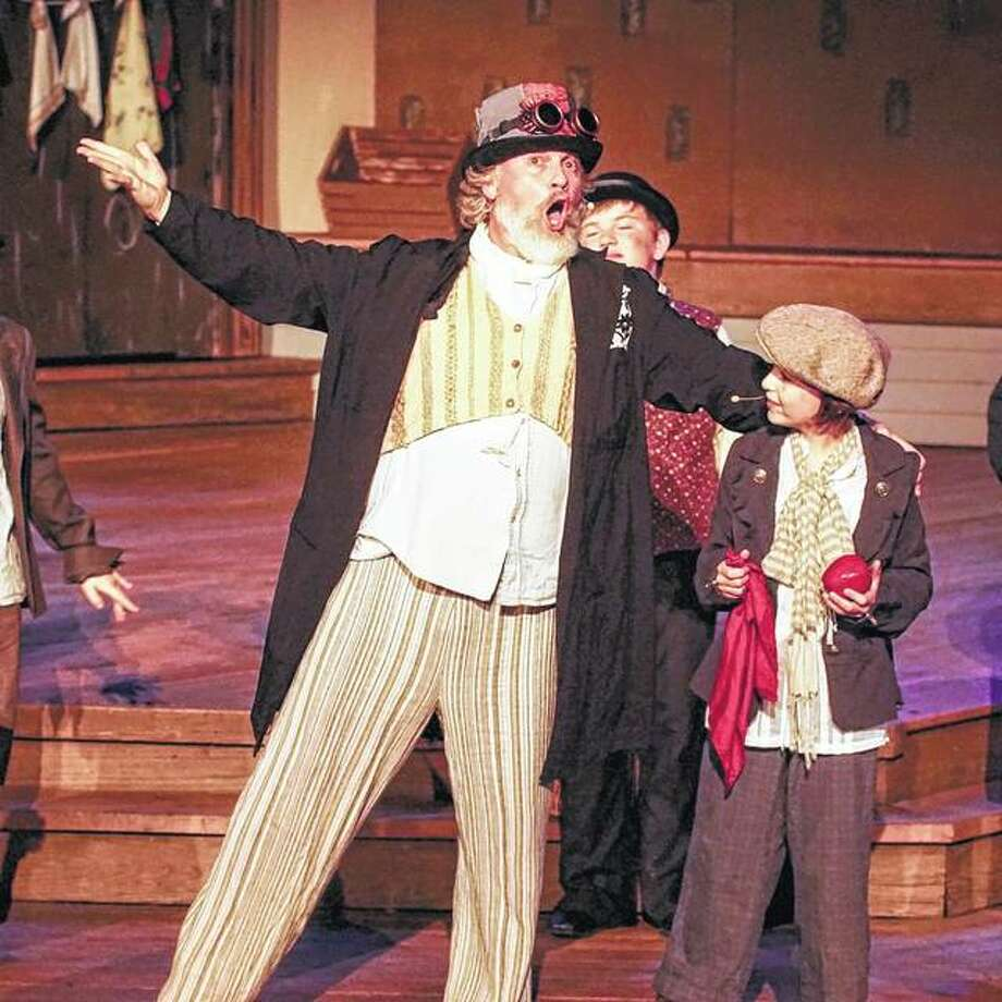 "J.B. George (left) as Fagin and Isabelle Stewart as Oliver rehearse a scene from Theatre in the Park's production of ""Oliver!"" at New Salem State Historic Site in Petersburg. The play opens Friday. Photo:       Photo Provided"