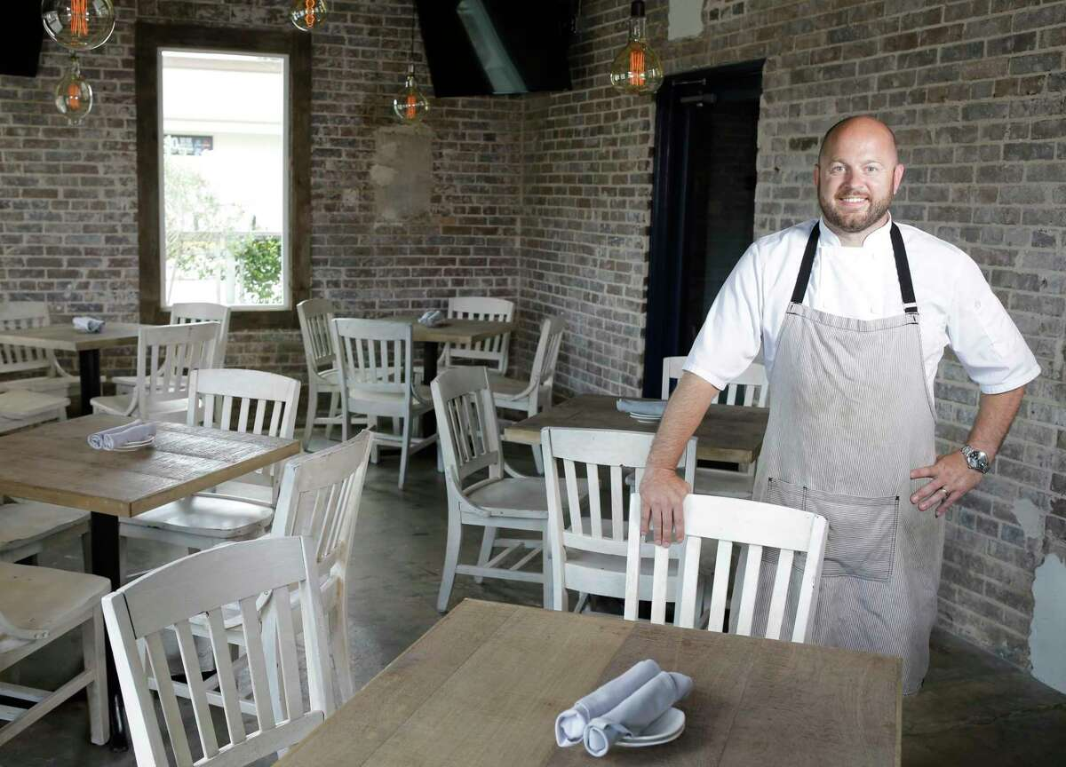 Chef Travis Lenig poses in the Lounge at Field & Tides, a new bar and patio and Field & Tides restaurant, 705 E. 11th St. in the Heights.