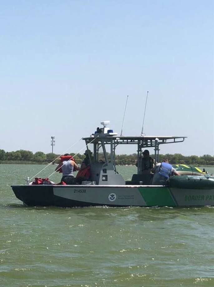Border patrol agents on a training exercise at Lake Casa Blanca rescued 3 men in an inflatable raft. Photo: Courtesy