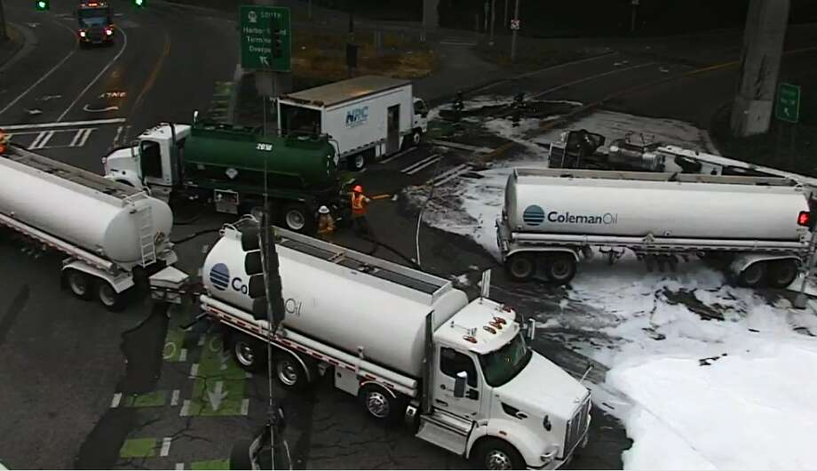 A fuel tanker overturned near the west end of the West Seattle Bridge Wednesday night, leading to continued closures and traffic disruptions Thursday morning. Photo: SDOT