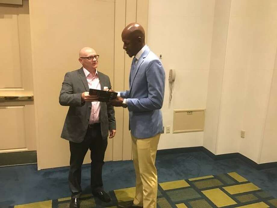 Ray Allen signs his book at the Middlesex Chamber of Commerce breakfast on Thursday. Photo: David Borges
