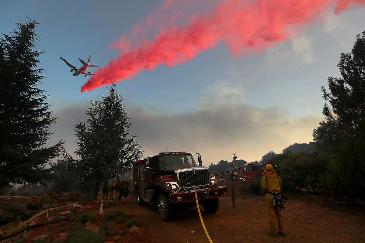A firefighting aircraft drops fire retardant ahead of the River Fire as it burns through a canyon on August 1, 2018 in Lakeport, California. The River Fire has burned over 27,000 acres, destroyed 7 homes and stands at 38 percent contained.