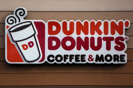 This Jan. 22, 2018, photo shows the Dunkin' Donuts log on a shop in Mount Lebanon, Pa. Massachusetts-based Dunkin' Donuts announced an updated menu on Friday, July 27, which is featuring the company's first gluten-free product - a fudge brownie. (AP Photo/Gene J. Puskar)