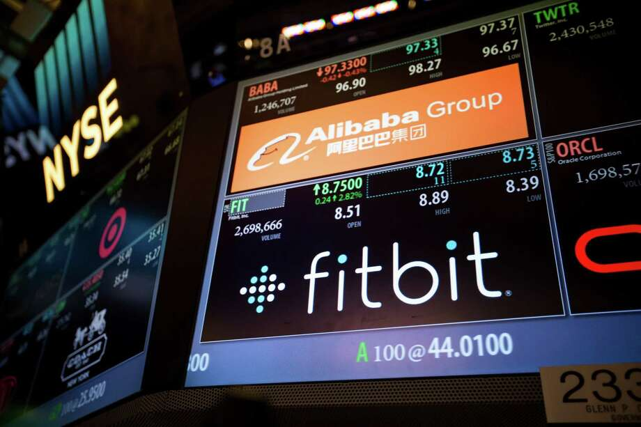 Fitbit signage is displayed on the floor of the New York Stock Exchange (NYSE) in New York on Nov. 4, 2016. Photo: Bloomberg Photo By Michael Nagle / © 2016 Bloomberg Finance LP