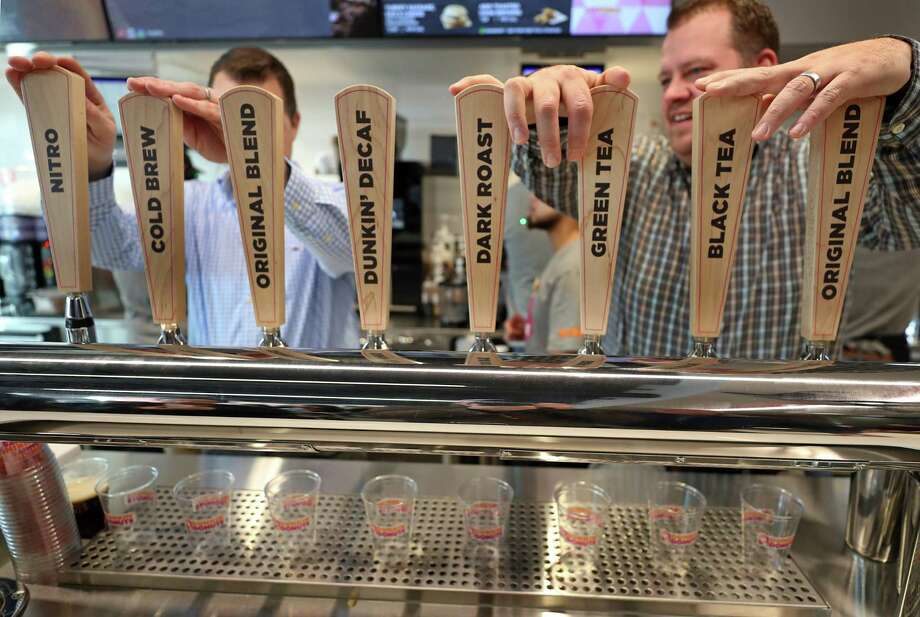 "The ""next generation"" Dunkin' Donuts include a brewpub-style tap system for cold beverages. Photo: Boston Globe /Boston Globe Via Getty Images / 2018 - The Boston Globe"