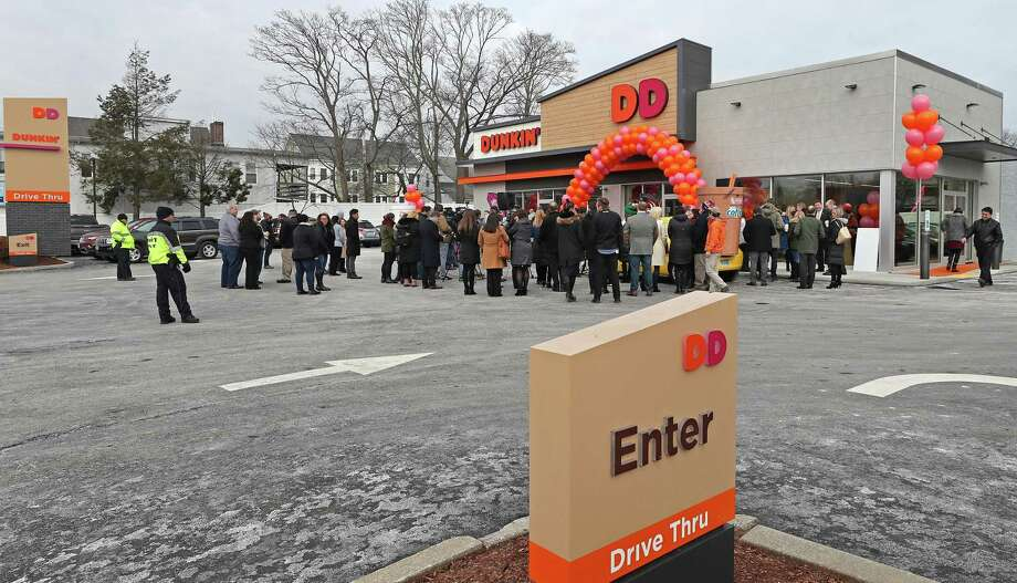 Customers Line Up To Check Out The First Next Generation Dunkin Donuts Store