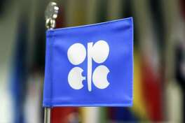 The flag of OPEC stands on a desk ahead of the 174th Organization Of Petroleum Exporting Countries (OPEC) meeting in Vienna, Austria, on Friday, June 22, 2018. OPEC and its allies reached a preliminary agreement in the face of strong opposition from Iran to boost production by a theoretical 1 million barrels a day - the actual increase will be smaller as several countries are unable to raise output. Photographer: Stefan Wermuth/Bloomberg