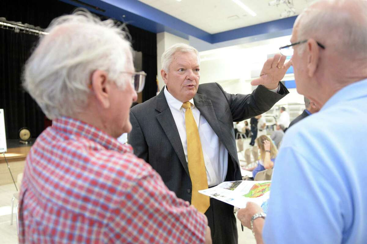 Precinct 3 Commissioner Steve Radack discusses the Flood Control Bond Proposal with residents at a Harris County Flood Control Community Engagement meeting for the Barker Reservoir Watershed at Memorial Parkway Junior High School, Katy, TX, on August 1, 2018