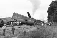 A Southern Pacific freight train derails spilling 14 cars off the tracks near the Burlingame - Millbrae border August 20, 1953