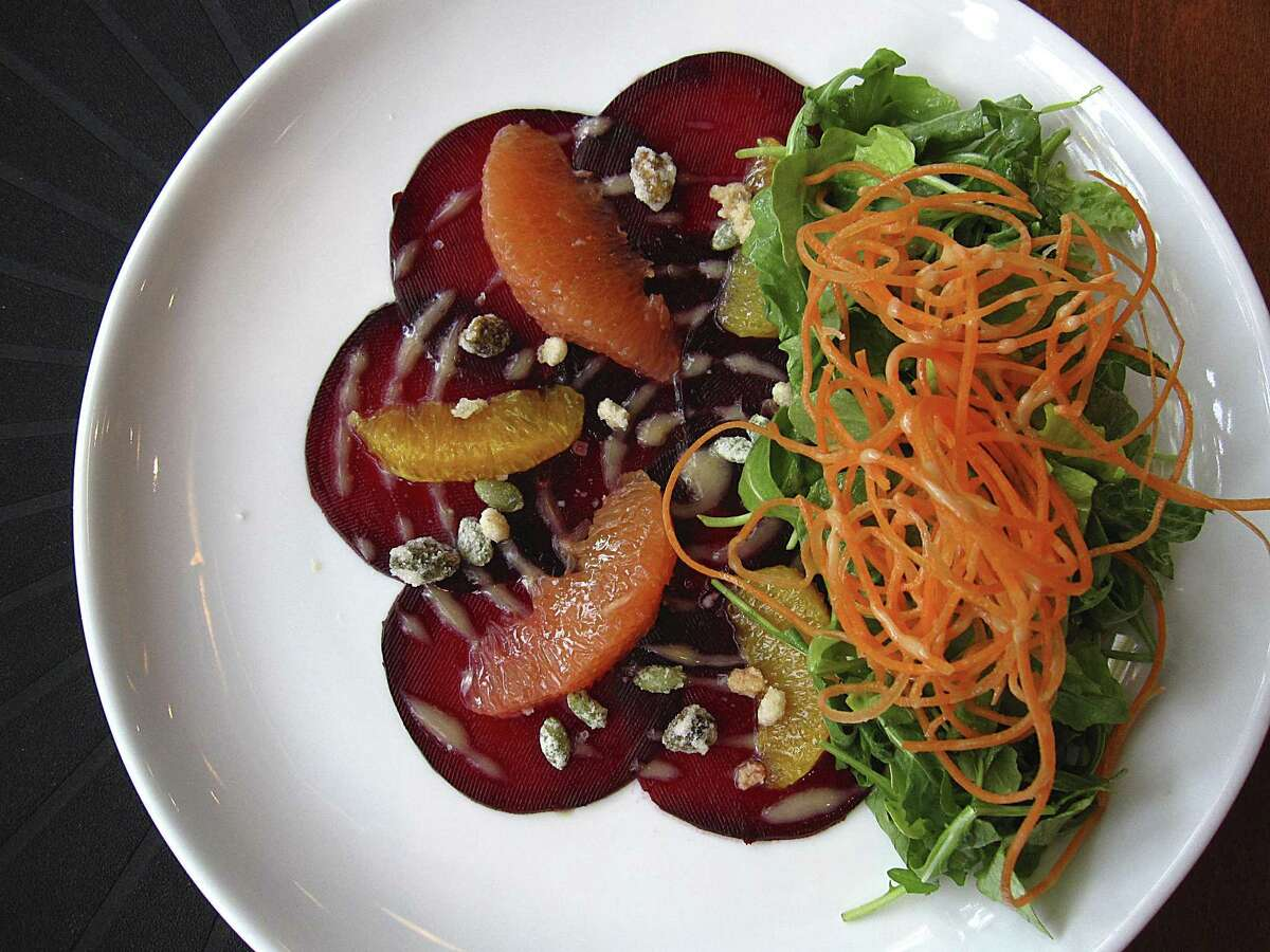 Beet salad with arugula, citrus and candied nuts from Spoon Eatery.