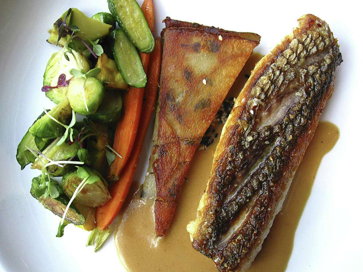 Pan-seared red snapper with ginger-soy sauce, vegetables and potato galette from Spoon Eatery.