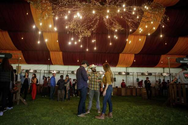 Festival goers mingle in the Wine Lands tent during the 10th annual Outside Lands Festival in Golden Gate Park in San Francisco on Friday, August 11, 2017.