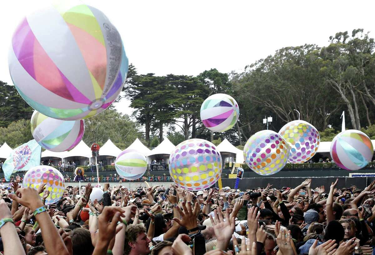 Fans hit beach balls into the air while Dr. Teeth and The Electric Mayhem perform at Outside Lands music festival in Golden Gate Park in San Francisco, California, on Sunday, August 7, 2016.