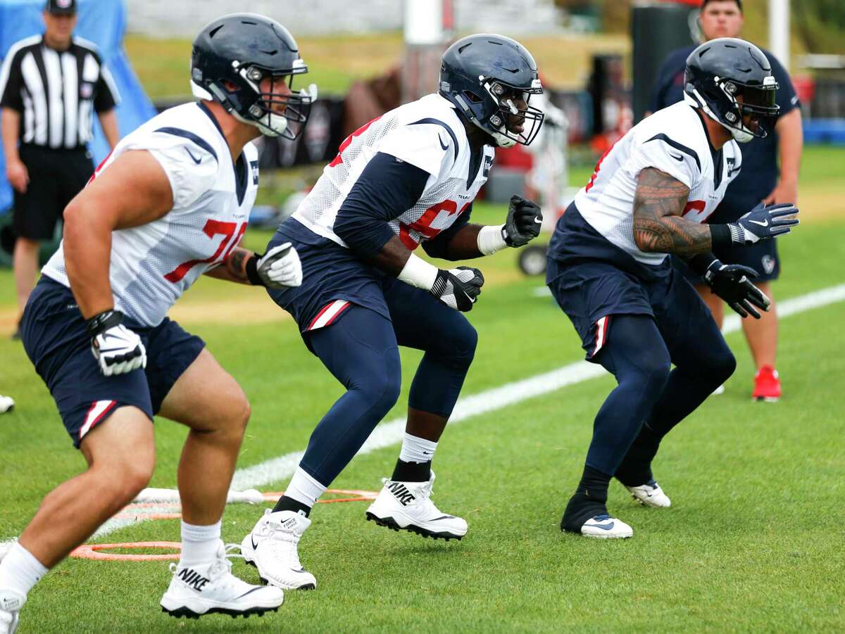 Houston Texans offensive linemen run a drill during training camp at the Greenbrier Sports Performance Center on Thursday, Aug. 2, 2018, in White Sulphur Springs, W.Va.