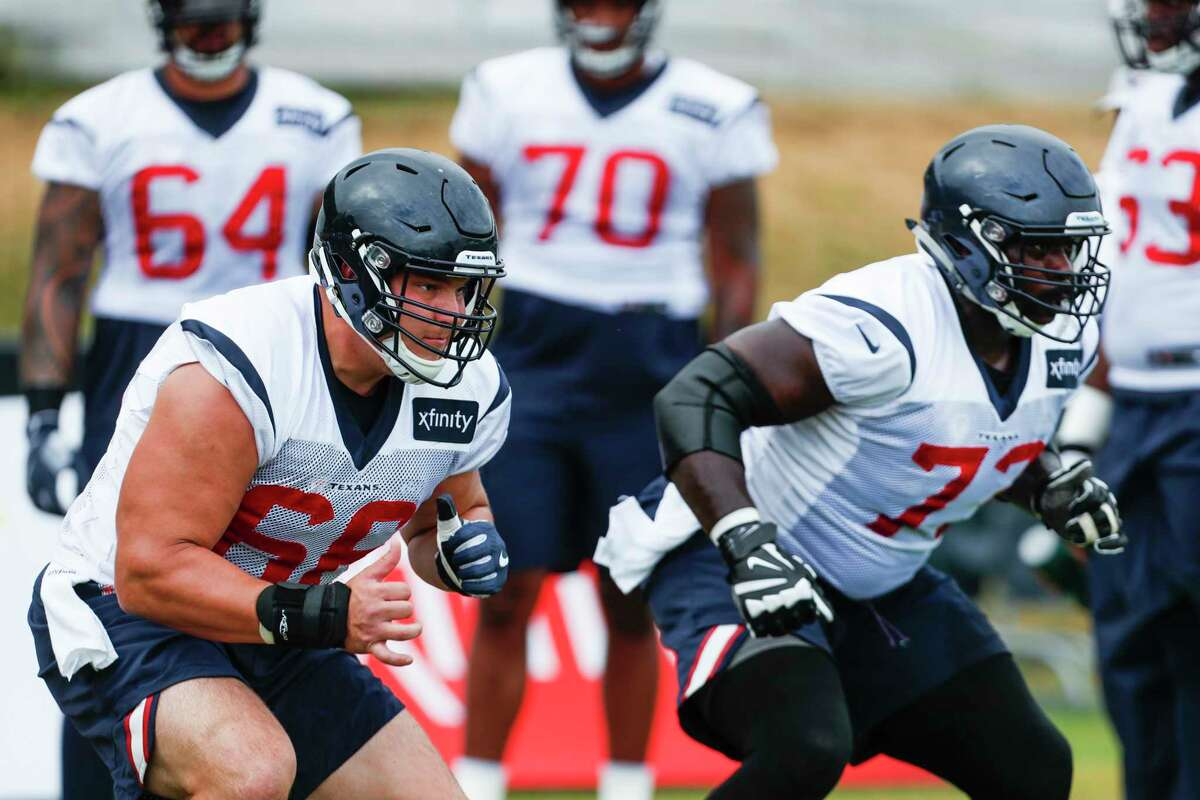 Houston Texans center Nick Martin (66) and guard Zach Fulton (73) run a drill during training camp at the Greenbrier Sports Performance Center on Thursday, Aug. 2, 2018, in White Sulphur Springs, W.Va.
