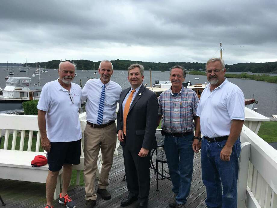 The town of Essex is working on an update of the management plan for its small harbor on the Connecticut River. From left are Essex Harbor Commission Chairman Jeff Going, First Selectman Norm Needleman, Connecticut Port Authority Chairman Scott Bates, Harbor Master Paul Riggio, and Doug Domenie of Brewer Yacht Yards. Photo: Contributed Photo