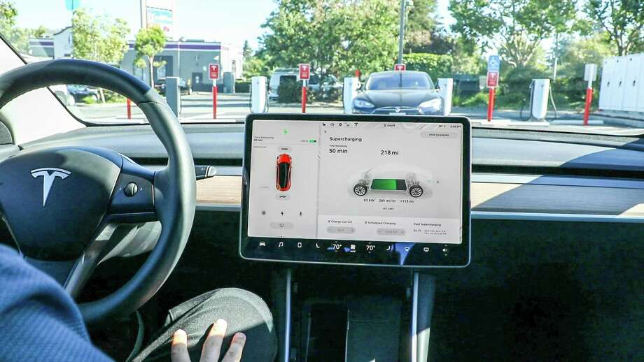 behind the wheel of a tesla model 3 it s a giant iphone for