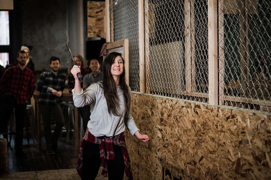 Axe-throwing bar Blade and Timber, based in Kansas City, Mo., will expand to Seattle's Capitol Hill in the fall. It invites people to come in and chuck axes at a target -- with training, of course. Photo: Timber And Blade