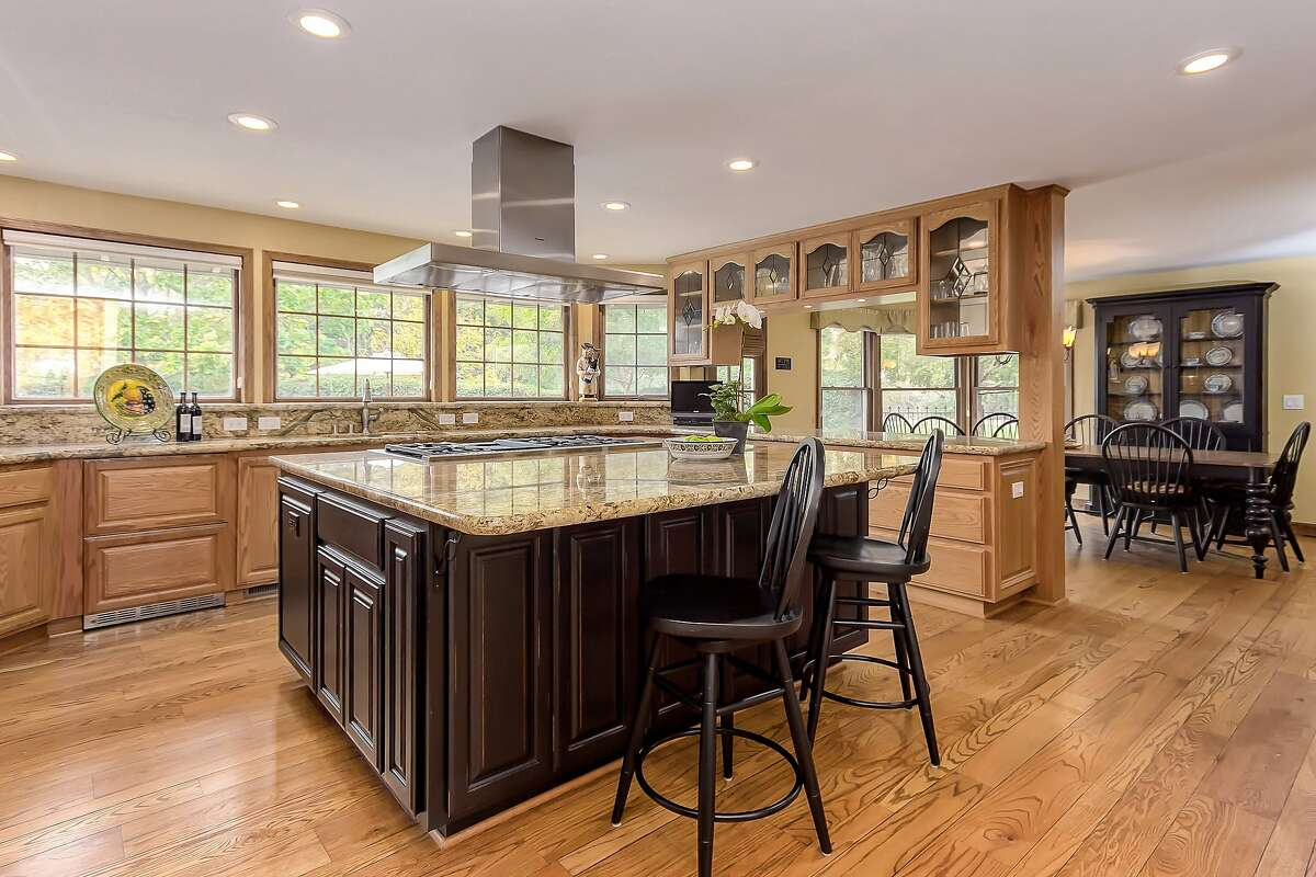 The open kitchen at 49 Red Cedar Court in Danville offers a bar counter.�