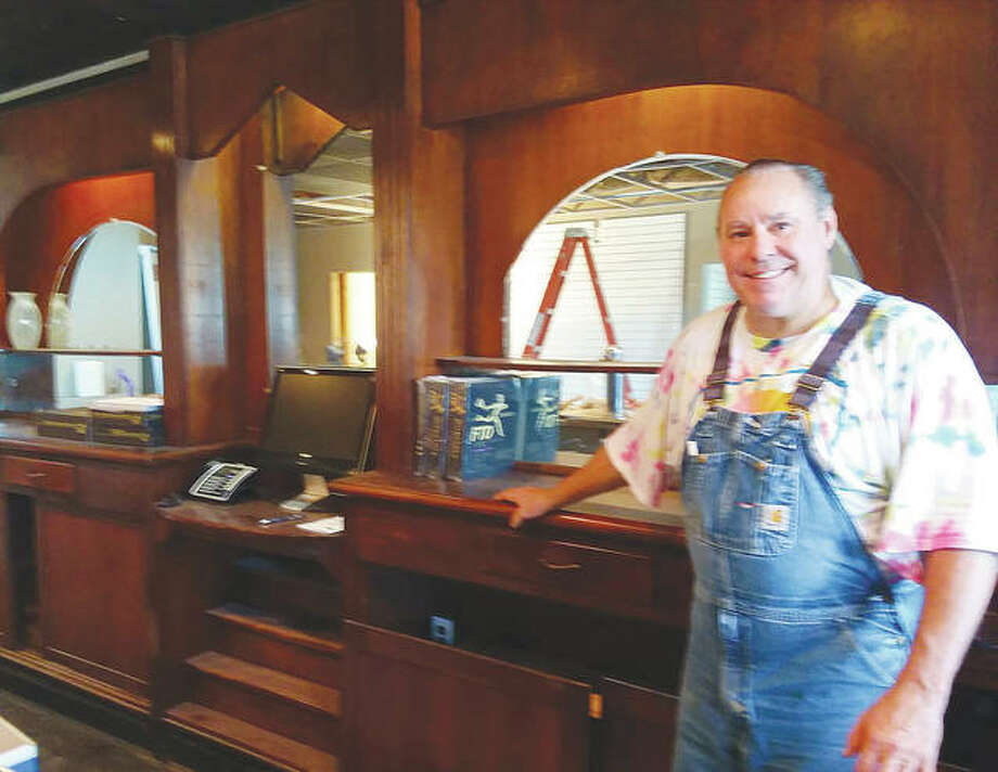 Walter Bergman, with Krupp Florist, stands behind the bar at the former Hi-Way Tavern and Cafe at 463 E. Vandalia St. The building is being renovated this summer to prepare for the florist to move in. Photo:       Steve Horrell/Intelligencer